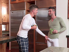 Latino handsome gay dude gets his face sprayed with cum in the kitchen