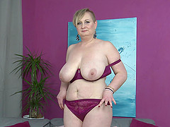 Short haired mature blonde Silana masturbates on the couch