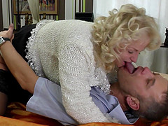 Blonde granny Shery surprises a young friend with a blowjob