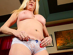 Amateur mature busty blonde MILF Sara S. strips and masturbates