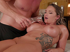Huge tits of Cali Carter are oiled up and ready for a hard cock
