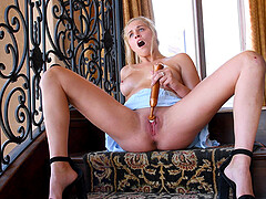 Blonde amateur Sophia masturbates on the stairs in high heels
