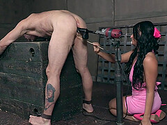 Kinky dark haired strict mistress ties up and abuses her male slave