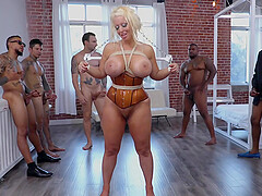 Buxom blonde in a latex corset Alura Jenson abused in a gangbang