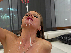 Slender babe Tina Kay gets sprayed with cum in a MMF threesome