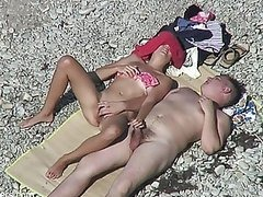 Hot Couple Stimulating Each Other on a Nude Beach